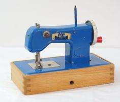 Child's blue sewing machine - reminds me of my mum's first sewing machine ~ it came from Santa!