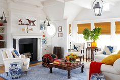 Pops of yellow, red and blue for the white living room with Asian theme