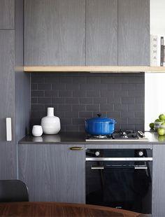 black matt subway tile splashback. Graphite Apartment - Mim Design