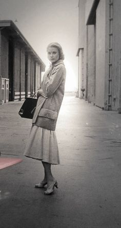 Grace Kelly - so simply everyday elegant and note her smart heel height. They make heels entirely too high now; a woman tottering around on her tip toes is not sexy.