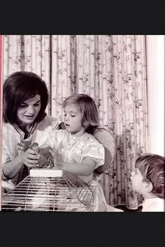 Jacqueline Kennedy plays with her two children, Caroline and John Jr. on the occasion of their 5th (11/27/62) and 2nd (11/25/62) birthdays respectively.