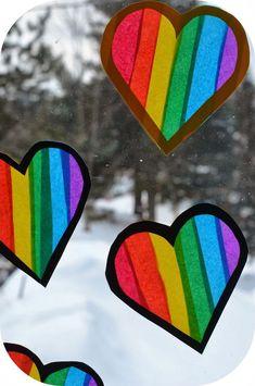 Happy rainbow heart suncatchers! A beautiful craft for winter around Valentine's Day! #heartcrafts #ValentinesDay