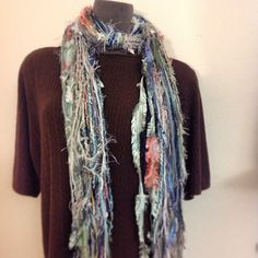 Fun scraggle scarf in variegated blues, whites, cream & browns.