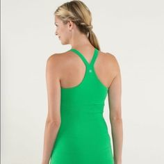 Lululemon Ebb to Street Tank In Heathered Green 8 Lululemon Ebb to Street tank in heathered green bean. Soft, stretchy seamless fabric moves with you. Designed with pockets for removable cups if you want extra coverage. Has a built in shelf bra. Size 8 NO trade and NO pal. Selling on MERC FOR LESS lululemon athletica Tops Tank Tops