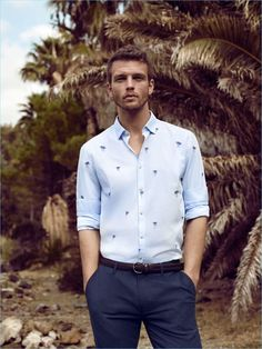 Front and center, Benjamin Eidem dons a smart patterned shirt with trousers by Lufian.