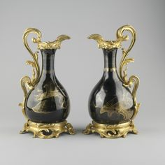 """*1730-1750 Chinese Vases in the Royal Collection, UK - From the curators' comments: """"Pair of bottle shaped vases mounted as ewers, in black glaze decorated with mythical birds in gold tracery and fitted with gilt bronze mounts. Mounts include a lip, serpentine handle and pierced base, all chased with acanthus foliage."""""""