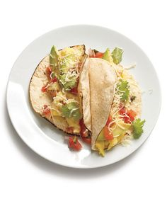 Mix things up: Serve tacos for breakfast or breakfast tacos for dinner. Here, toasted tortillas hold creamy scrambled eggs rather than ground beef. Sliced avocado, salsa, cheese, and cilantro round out the meal. For an extra-special treat the whole family will love, serve with breakfast potatoes.