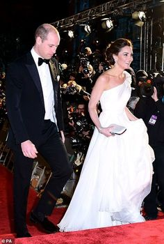 Dapper: Prince William wore a black dinner suit to the star-studded occasion. The duke, who is the president of BAFTA, presented its highest accolade, the Fellowship, to film editor Thelma Schoonmaker during the ceremony Kate Middleton Prince William, Prince William And Catherine, William Kate, Prins William, Duke And Duchess, Duchess Of Cambridge, Burgundy Gown, Black Dinner, Kate Middleton Style