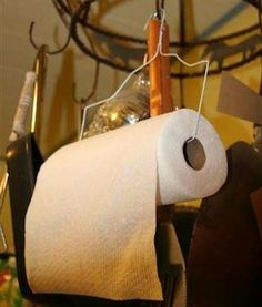 How to make a quick and easy (maybe not pretty, but functional) paper towel holder with just a wire coat hanger.