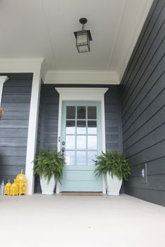 front door color: Martha Stewart 'Salvia', a minty green.