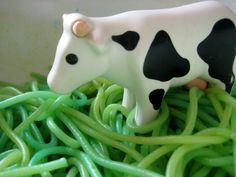 Now what child wouldn't want to play with green spaghetti and a farm set?!  Sensory play.