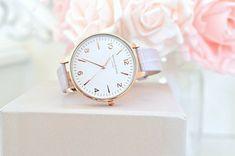 Relógio branco com dourado feminino