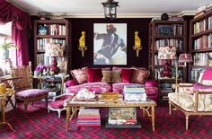 Inside the stunning home of the Ultimate A-list decorator: Alex Papachristidis. Rich textiles create a cocoonlike feel in the library. Deep purple velvet lines the walls, and the étagères feature a fabric overlay. The chevron carpet is one of Alex's own designs for Langhorne. Photo by Lesley Unruh. One Kings Lane Designer Houses.