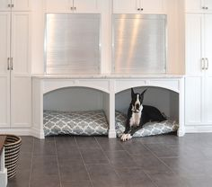 Built-in Dog Beds. Mudroom. Mudroom with Built-in Dog Beds, cabinets and aluminum garage doors for storage. #BuiltinDogBed #DogBed #Mudroom Redstart Construction.