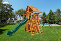 """The Ultimate Swing Set #5 comes with a 6' playdeck platform and a 12' wave slide. This swing set includes a cedar wood roof, bottom playhouse, wooden step ladder, accessory arm and an additional sling swing. What a great """"hideout"""" for the kids! The bottom playhouse is huge, and with almost 6' of standing room inside, adults can fit, too!  Swing set comes complete with everything pictured."""