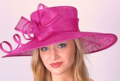"""Dramatic fuchsia pink Kentucky Derby hat with a 5-6"""" brim hat trimmed with matching bow & loops of sinamay. This hat will set you apart in the Derby crowd!   Hat-a-tude.com"""