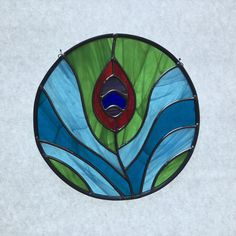 Stained glass peacock feather suncatcher, stain glass feather, blue and green bird by FoxStainedGlass on Etsy
