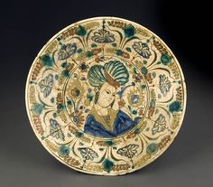 Plate  Persian, Safavid period (1501-1722/36) Circa1600  Pottery, polychrome painted decoration on white engobe under transparent glaze  6.5 cm (h.), 33.6 cm (diam.