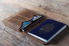 Avoid misplacing important document while traveling by keeping them safe inside this personalized leather passport wallet. It comes with storage space for everything from your passport to cash, and is customized with your initials on the front cover. Leather Wallet Pattern, Leather Passport Wallet, Handmade Leather Wallet, Leather Card Wallet, Leather Gifts, Diy Leather Passport Holder, Diy Passport Holder, Leather Craft, Mens Travel Wallet