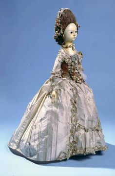 Doll, 1775.  Carved and painted wood, silk, linen and wool. Size: Height: 54 cm