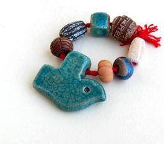 Ceramic pendant Dove pottery Raku a set for