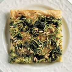 Pizza with zucchini, pesto and pine nuts