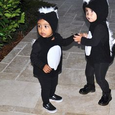 "North West & Penelope Disick Check out these adorable little stinkers! The cute cousins wear matching skunk costumes for Halloween. ""My babies,"" auntie Khloé Kardashian affectionately"