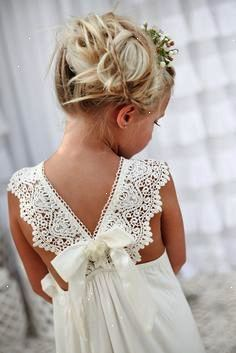 What a precious little flower girl. Love this beach dress with lace straps and whimsical hair.