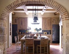 Italian farmhouse kitchen.  Love it!!! bring on the exposed brick!  Bring on the beams!!  Bring on the giant table for 14!
