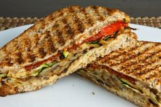 Grilled Vegetable Panini: 2 zucchini (cut into thin slices)  1 eggplant (cut into thin slices)  * olive oil  oregano, salt and pepper to taste  4 roasted red peppers  1 cup feta (crumbled)  4 tablespoons hummus  8 slices of bread  balsamic vinegar