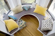Circular windowseat - someday I will have a home with a windowseat. I'll sit there on rainy days with my pups curled up with me, a cup of hot tea and a good classic to read. Perfection.
