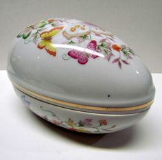Vintage Avon 1974 DECORATIVE CERAMIC EGG with Butterfly's and floral designs Trinket Container / Trinket Box / Keepsake Box - Home Decor by VINTAGEandMOREshop on Etsy https://www.etsy.com/listing/243986354/vintage-avon-1974-decorative-ceramic-egg