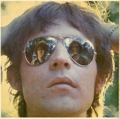 Eric Clapton and Ginger Baker reflected in Jack Bruce's sunglasses Cream