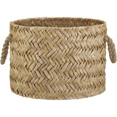 """Cebu basket made of bangkuang fibers in a herringbone weave, from Crate and Barrel. Abaca rope handles. This basket is 17"""" in diameter, so it can hold a lot of toys, balls of yarn, or just about anything you have a lot of!"""