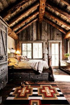 I dig the hell out of this cabin. Love the rustic vibe and the exposed beams. Very organic.