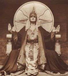 Mia May  German Silent Film - Die Herrin Der Welt (The mistress of the world) 1919 She is  sitting on a throne with the symbol for Shamash (a native Mesopotamian deity and the Sun god in the Akkadian, Assyrian, Babylonian, and Canaanite pantheons)