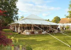 The Pearl Tent Company offer some beautiful examples with proper linen and wooden poles. Interiors include country theme lace and frills styling. Not tacky.