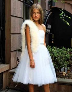 Cover your shoulders with a faux fur shrug to go with your Bat Mitzvah dress.