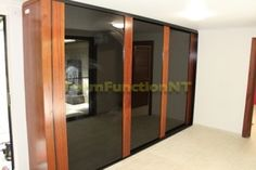 """""""The Infinity"""" Sliding Doors.   Black Glass with decorative fern motif.  Solid Merbau timber frames"""