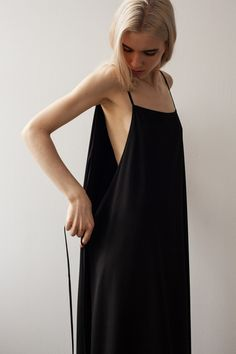 From the Shaina Mote Core Collection, the Apron Dress is a versatile style with a front and back panel that can be tied different ways around the waist for different looks. Features a square neckline,