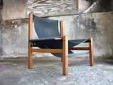 Fantastic chair. Made of heavy teak, steal and sailcloth. Still looking for a designer!!!