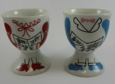 Singers who've lost their heads!  Matching egg cups.