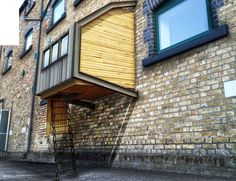Parasitic pod homes attach to buildings to provide additional ...