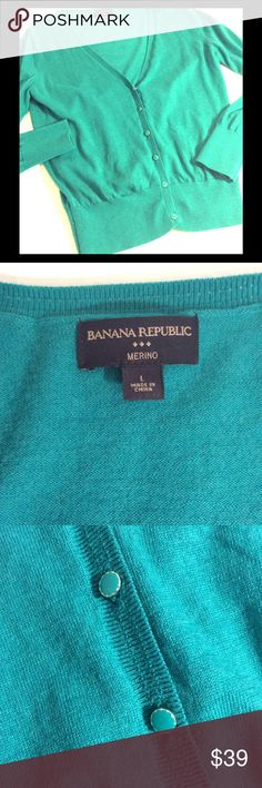 """BANANA REPUBLIC✨M E R I N O  WOOL✨GREEN-BLUE CARDI BANANA REPUBLIC, teal green blue, fine MERINO wool cardigan sweater, with beautifully detailed buttons. Labeled size large, but fits women's size 8-10. If size 10, will be more form fitting. Extra fine knit, hand wash, SLIGHTLY wrinkled but LIKE NEW.  MEASURES 19"""" armpit to armpit, 23.75"""" sweater length from shoulder, 24"""" sleeve from shoulder.  Beautiful color! Suggested User, Fast Shipper. Banana Republic Sweaters Cardigans"""