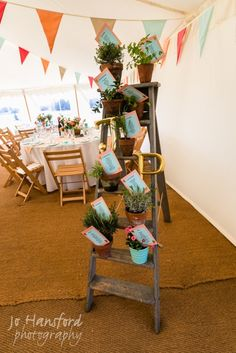 Do something a bit different with your table plan board! Ladders, pots and letters work perfectly!  www.abbasmarquees.co.uk
