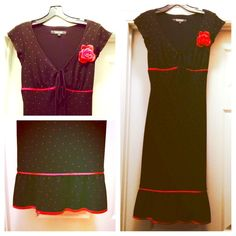 Black polka dot dress Black with small red polka dots. Fit and flare. True to size. Detachable red flower. Would be beautiful to wear to a dance or party. Rampage Dresses