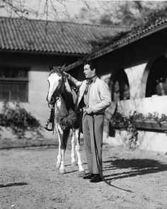 Vintage Photographs From the Hotel Bel-Air, Los Angeles. Robert Taylor stables his horse in Bel-Air, 1937