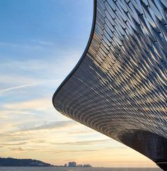 Lisbon's glistening Museum of Art, Architecture and Technology opens its doors Industrial clout meets sleek modernity | via The Spaces | 4/10/2016 To someone walking along the waterfront in Belém, Amanda Levete Architects' new museum is unobtrusive to the point of invisible until one is almost upon it. While hardly a quiet design, the museum building hunkers into its landscape, sending out low curves that sparkle at the edges thanks to a façade covered in .... Photography: Hufton + Crow