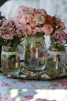 Lace and pearls around jar mouths, to use as vases.