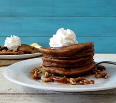 Sweet Potato Pie Pancakes with Bourbon Maple Syrup  - A light, fluffy, moist pancake filled with sweet potatoes and pecans topped with a bourbon infused maple syrup.